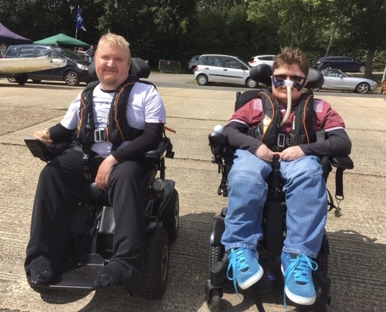 Boys in wheelchairs